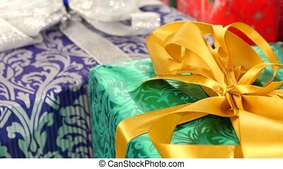 Different boxes, gifts tied with ribbons and bows isolated on white background, rotation, close up