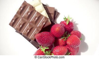 Different chocolate and strawberries