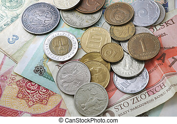 different coins lying on the paper money
