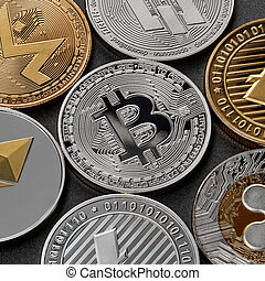 Different coins of crypto currency on a black background. Business concept.