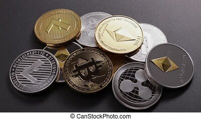 Different coins of crypto currency on a dark background....