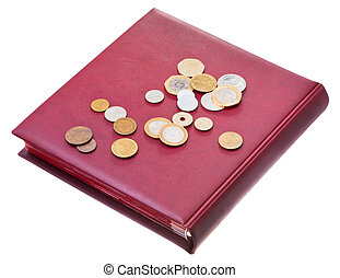different coins on red numismatics album and isolated on...