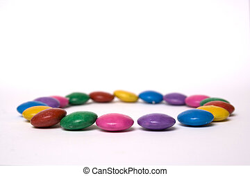 different color candy in a circle