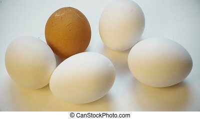 Different color egg cracked by hammer. Broken life. bullying...