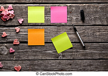 Different color sticky notes on wood table. - Different...