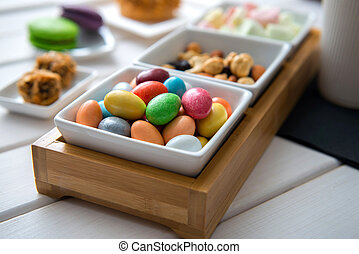 Different color sweets on bowl