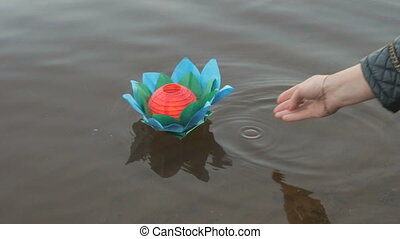 Different color water lily with candle on water - Festive...