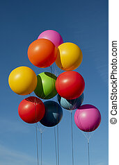 Different colored balloons in the sky