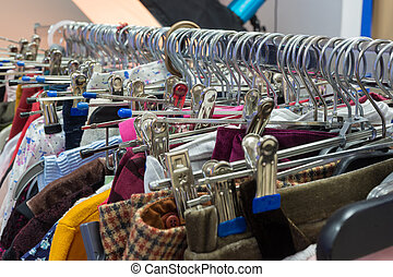 Different colored clothes on hangers
