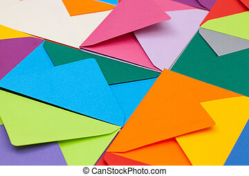 Different colored envelopes on the desk