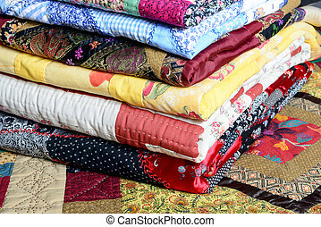 patchwork - different colored patchwork stacked on a table