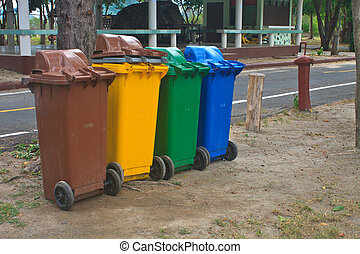 Different colorful recycle bins