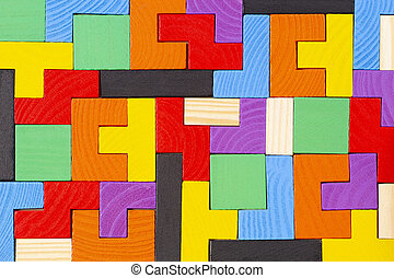 Different colorful shapes wooden blocks pattern background. Top view