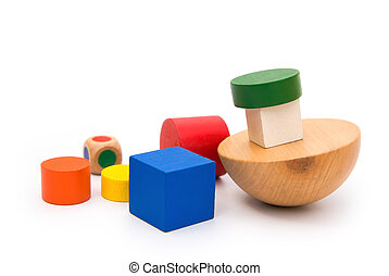different colors and shapes wooden blocks on white