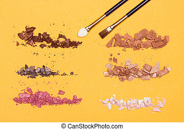 Different colors of crumbled compact eyeshadow