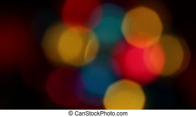 Different colors spots circling cycled at dark background