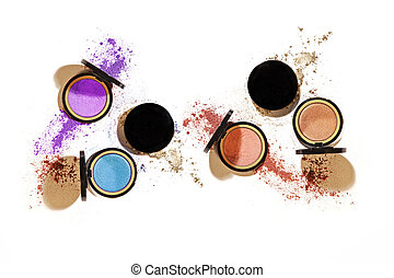 Different colours of eye shadow compact cosmetic make up at 45 degree angle isolated on white background with harsh shadows