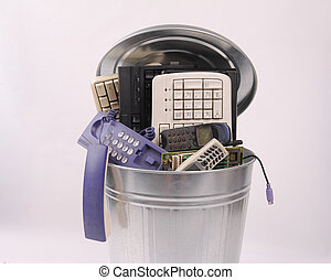 different computer parts in trash c