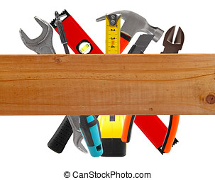 different construction tools and wooden plank
