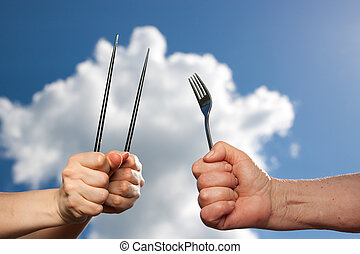 Different cultures, different cutlery, closeup
