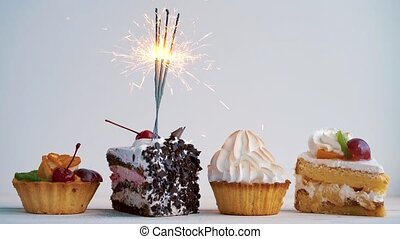 Different cupcakes with sparklers. Idea for holidays, birthdays, anniversaries, celebrations and parties