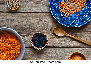 Different dishes with a lentil on a wooden table
