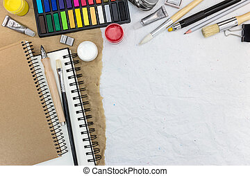 different drawing tools on recycled paper background
