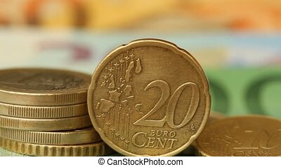 Different Euro coins on banknotes