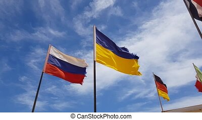 different flags flying