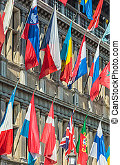 Different flags hanging on the town hall in Antwerp, Belgium