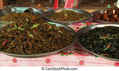 Different flavors of cooked spiders in Cambodia - A closeup ...