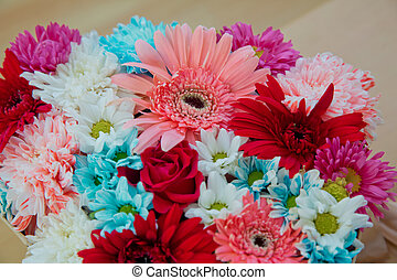 Different flowers in many bright colors in a mixed bouquet