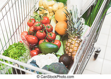Different food locating in supermarket trolley