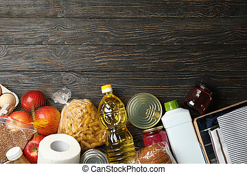 Different food on wooden background, top view. Donation concept