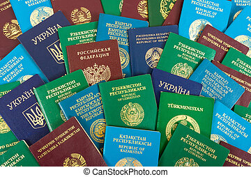 Different foreign passports as background