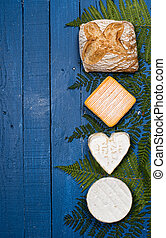 different french cheeses on blue wooden table