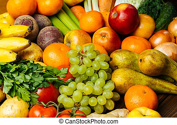 Different fresh raw vegetables and fruits background