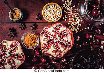 Different fruit and spices on the red wooden table. Concept of oriental fruits top view