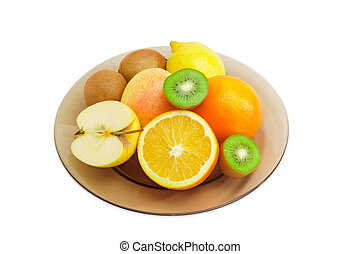 Different fruits on a glass dish