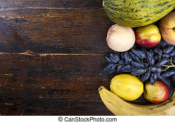 different fruits on wooden background