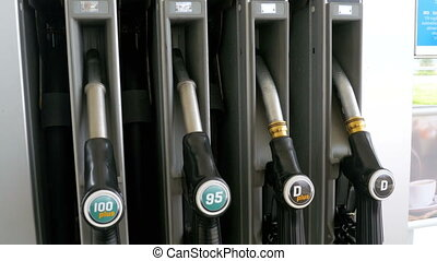 Different Gasoline gun at a petrol station. Gas fuel pump...