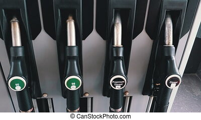 Different Gasoline Gun at a Petrol Station. Gas Fuel Pump ...
