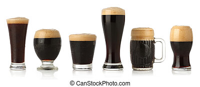 Different glasses of stout beer, isolated on white