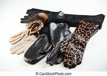 gloves - different gloves on white table