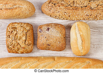 Different kind of breads on a wooden table