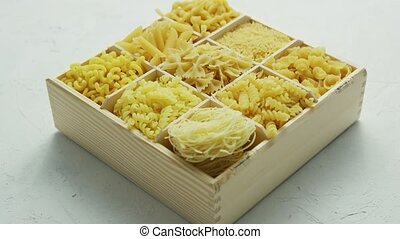 Different kind of macaroni in box - From above view of...