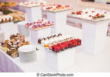 Different kinds of baked sweets on a buffet