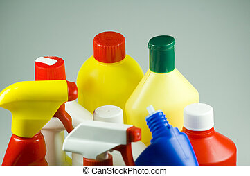 cleaning - different kinds of bottles with detergent and...