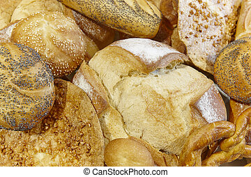 Different kinds of bread on a basket. Bakery.