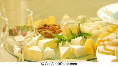 Different kinds of cheese on glass background.
